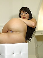 Black haired MILF with a stuffed butt | MyBigMILFBooty.com