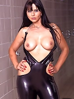 Gorgeous Desyra dressed in a latex | MyBigMILFBooty.com